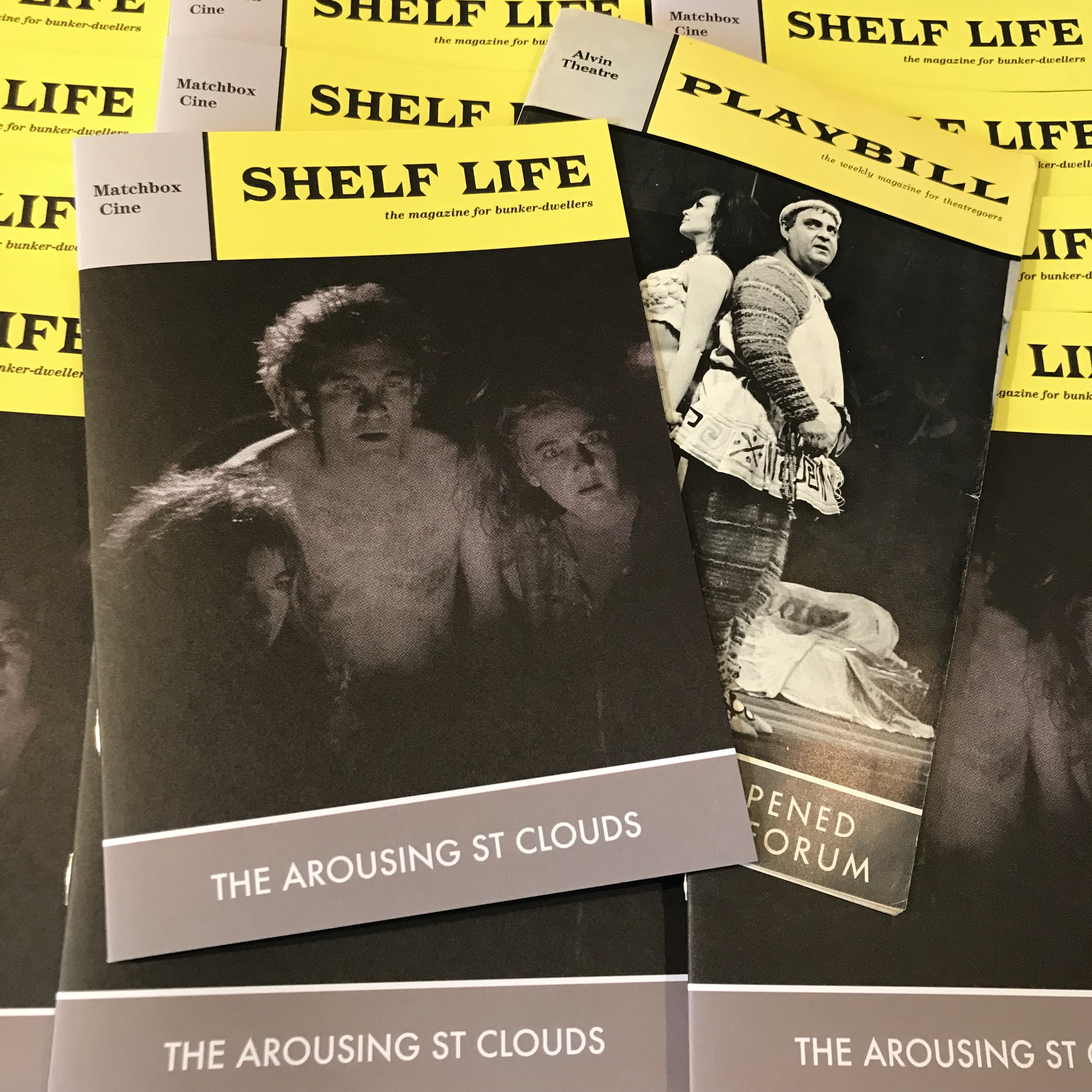 Pile of Shelf Life zines, designed in homage to a 1963 Playbill Magazine